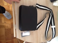 black and white leather sling bag