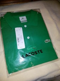 Brand New Lacoste Polo Size 6/Med Retails At 72.00