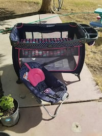 baby's black and pink travel cot and rocker