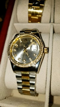round gold Rolex analog watch with gold link bracelet Brampton, L6T 4A2