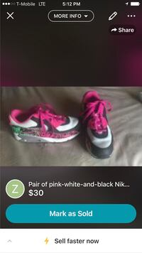 pair of black, white and pink Nike shoes advertisement screenshot