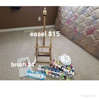brown wooden painting easel, brush, palette, and paint lot Lethbridge, T1K