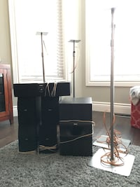 4 adjustable speaker stands wired.  2 main speakers, 2 surround speakers, center speaker and subwoofer  Barrie, L4N 0H8
