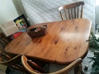 brown wooden table with chairs Fort Collins, 80524