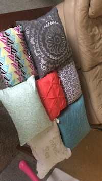 Decorative pillows never used they just sit In the closet