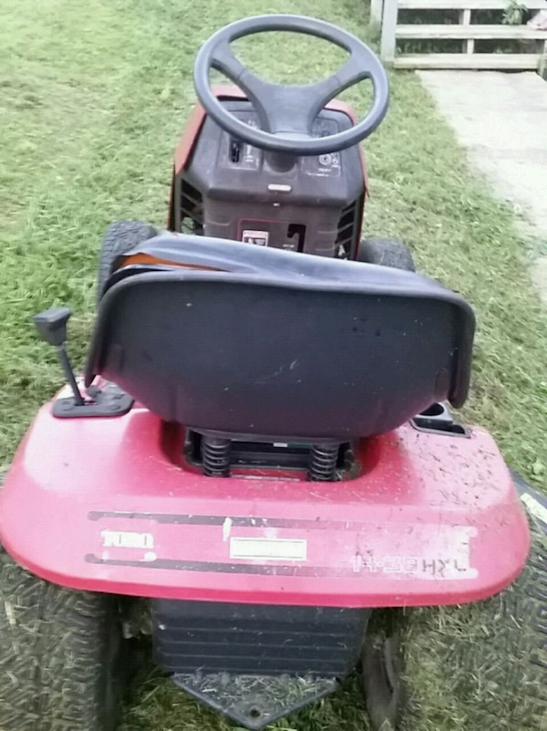red and black riding mower