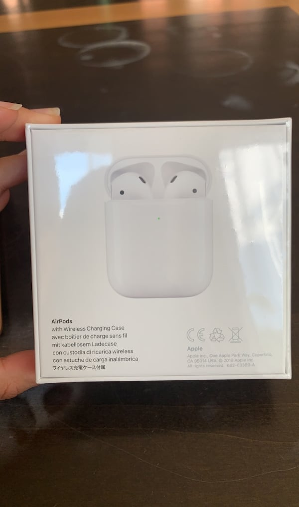 NEW Apple airPods with wireless charging case 8a5c9110-3f90-429e-9a3f-c6d4d43915da