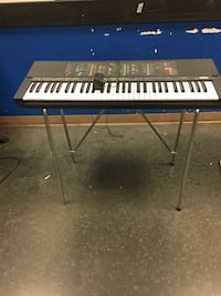 white and black electronic keyboard with stand