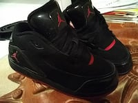 toddler's black-and-red Air Jordan basketball shoes