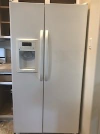 white side-by-side refrigerator with dispenser 1624 mi