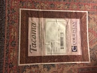 Persian style area rug. 5.6 by 7.3 feet. Dark red, black gold.  Has been professionally cleaned. Very good condition 31 km