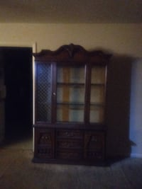 brown wooden cabinet with shelf null
