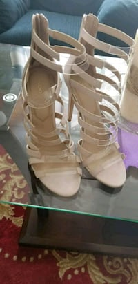 pair of white leather open-toe strappy heels Toronto
