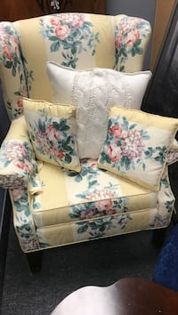 Yellow-and-multicolored floral wing chair and three throw pillows Mississauga, L4X 1L9