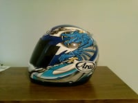 blue and white full face motorcycle helmet