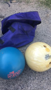 two blue and yellow bowling balls