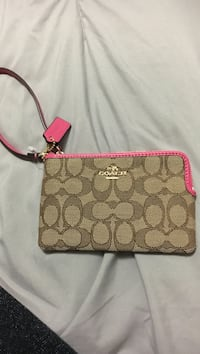 women's brown and pink Coach wristlet