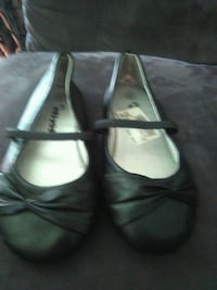 pair of black leather shoes Clarksville, 37042