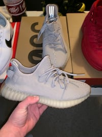 pair of white adidas Yeezy Boost 350 shoes 302 mi