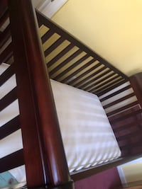 brown wooden bed frame and white mattress 46 km