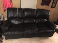 Black leather couch and brown couch Clinton, 39056