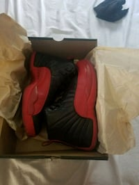 pair of red Air Jordan 12's in box Laredo