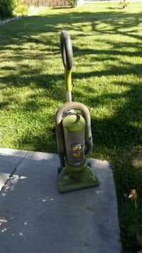 black and green Bissell upright vacuum cleaner Lancaster, 93536