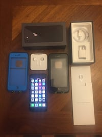 I Phone 8 64Gb charger,lightning headphones and 2 waterproof cases