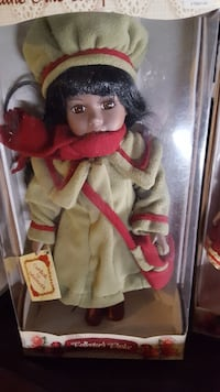 Collector's Choice girl doll in green and red coat.