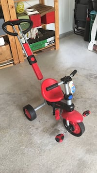 toddler's red and gray trike