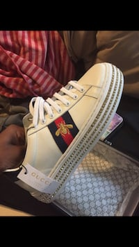 unpaired white and red Adidas low-top sneaker Baltimore, 21229