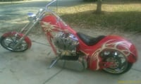 red and black cruiser motorcycle 34 mi