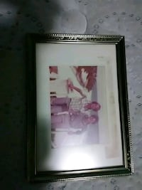 pink and white flower painting with black wooden frame Metairie, 70001