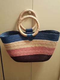 blue, beige, pink and maroon weave handbag