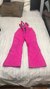 Pink snow suit. Used but in great condition. Rips at bottom of both legs but it's not noticeable when the grow along feature is used. Brand is lands end   New York, 11209