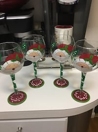 four clear wine glasses