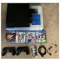 Sony PlayStation 4 with 2 controllers and games  Derwood, 20855