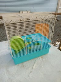 green and yellow pet cage Ferguson, 63135