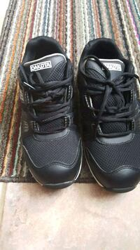 pair of black Nike running shoes Cambridge, N1S 1X2