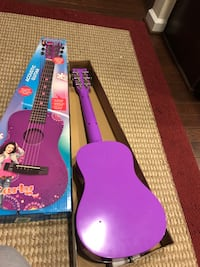 purple and black acoustic guitar with box Frederick, 21703