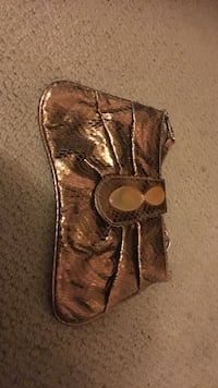 gold-colored leather bag