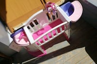 white, pink, and purple plastic dollhouse Greeley, 80631