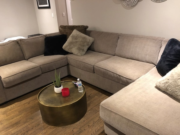 3-pc sectional sofa with throw pillows and table