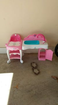 white, pink and blue high chair and sink toy set