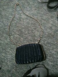 black and silver necklace with pendant