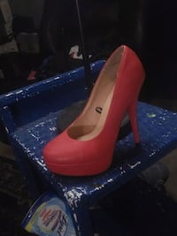 pair of red patent leather platform stilettos Red Deer