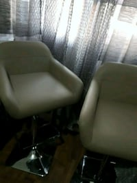 two green leather rolling chairs Longueuil, J4T 1P5