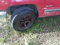 black and red 6-spoke car wheel with tire