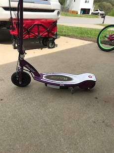 Girls electric scooter has charger