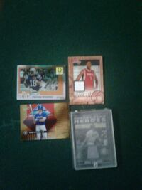 four basketball trading cards